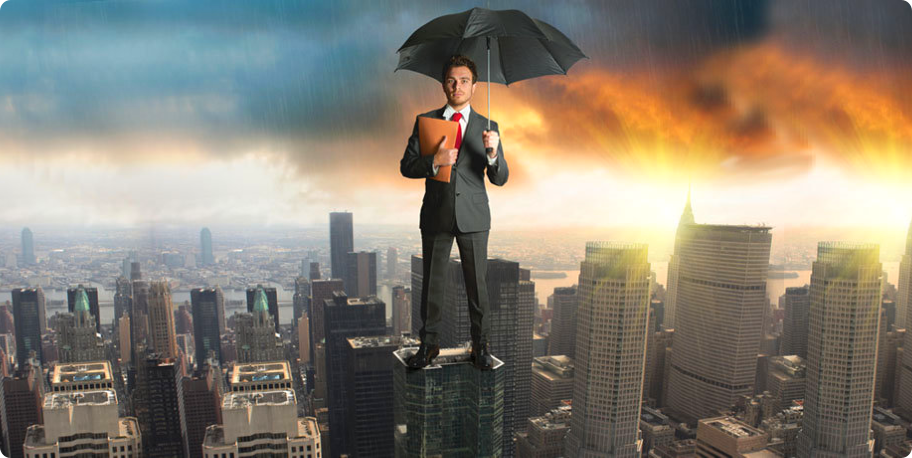 man holding an umbrella while standing on a building